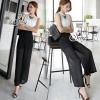 Sevy ชุดเซ็ท 2 ชิ้นสวยหรู เสื้อแขนกุดสีขาว + กางเกงขาวยาวสีดำ โทนสีขาวดำ สุคคลาสสิค